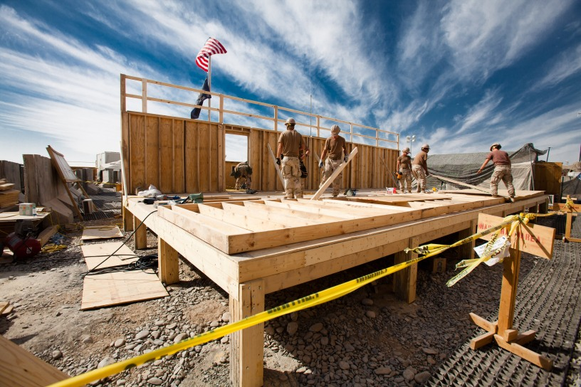 101104-N-6383T-507 KANDAHAR AIR FIELD, Afghanistan (Nov. 4, 2010) Seabees assigned to Naval Mobile Construction Battalion (NMCB) 18 build a Southwest Asian Hut at Kandahar Air Field. NMCB-18 is a reserve component battalion operating in the RC South Region of Afghanistan. (U.S. Navy photo by Utilitiesman 2nd Class Vuong Ta/Released)